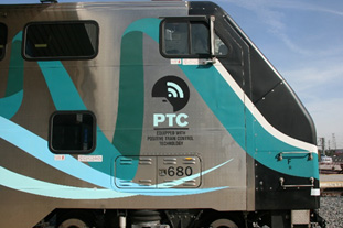 Metrolink train with a PTC logo on it
